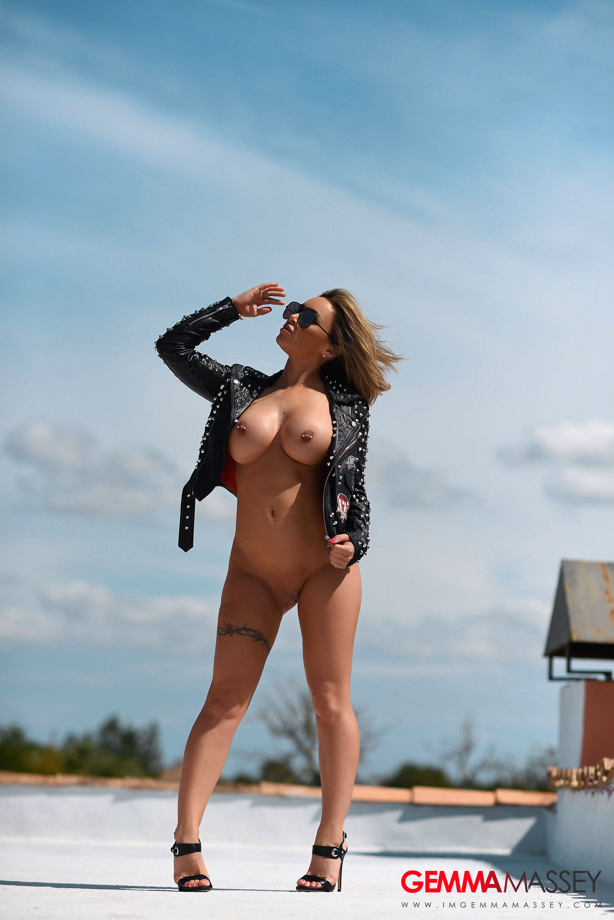 busty goddess Gemma Massey outdoors